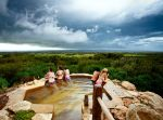 Peninsula Hot Springs hill top pool storm